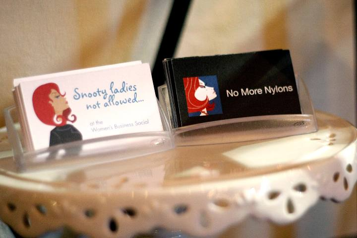 Business cards on a stand by Jodi Womack